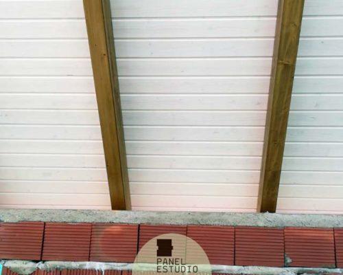 Construcción panel friso blanco.